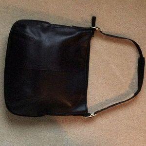 Large black leather shoulder strap Coach bag.
